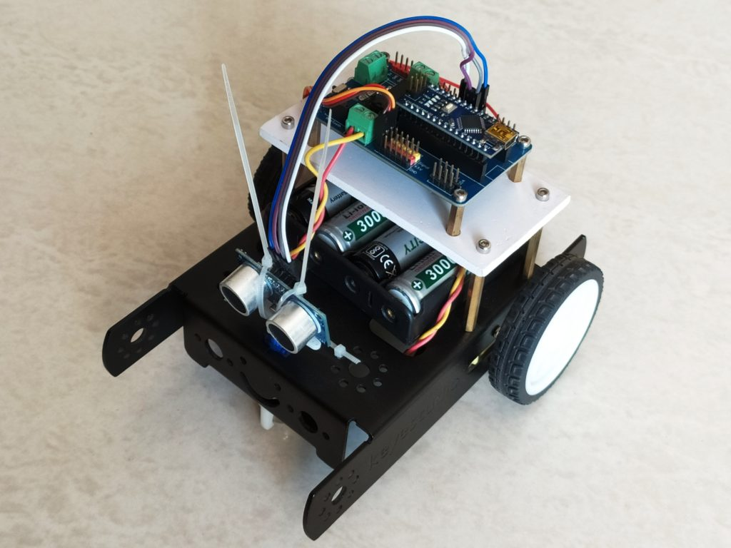 Ultrasonic obstacle avoiding robot using arduino nano and nano robot controller board